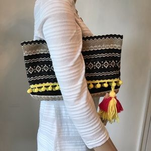 Fold Over Clutch with Pom Poms and Tassel Zip